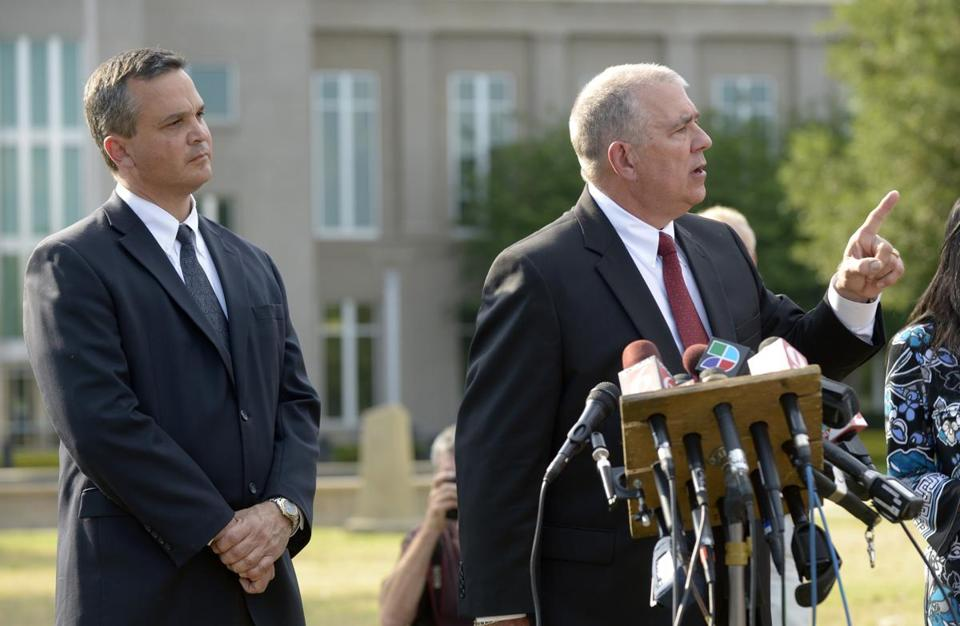 Hal Uhrig, right, and Craig Sonner told reporters they had quit as George Zimmerman's legal representatives in Sanford, Fla., Tuesday.