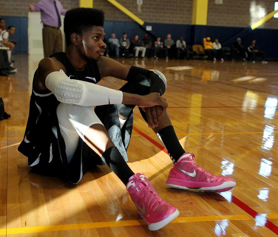 His 6-foot-10-inch frame, high top fade, and pink sneakers make Nerlens Noel a standout  - as do his basketball skills.
