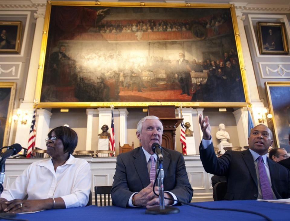Massachusetts Gov. Deval Patrick, right, sits on a panel with chairman of Partners HealthCare Jack Connors, center, and health care client Mona Rudolph, left, at Faneuil Hall in Boston. Gov. Patrick and the other participants were celebrating the sixth anniversary of Massachusetts' landmark health care law that was signed by former Gov. Mitt Romney at Faneuil Hall in 2006.