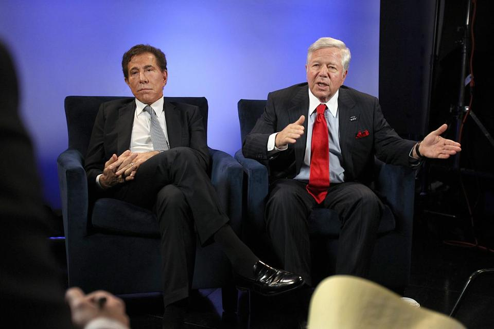 Robert Kraft, right, and Steve Wynn, talk to reporters about the casino plan in a studio at the Patriots complex.