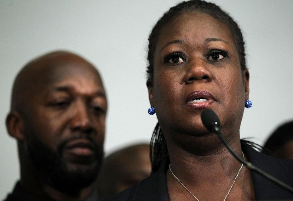 Sybrina Fulton, mother of Trayvon Martin, spoke as Martin's father Traci Martin listened after the announcement that George Zimmerman had been charged in Martin's death.