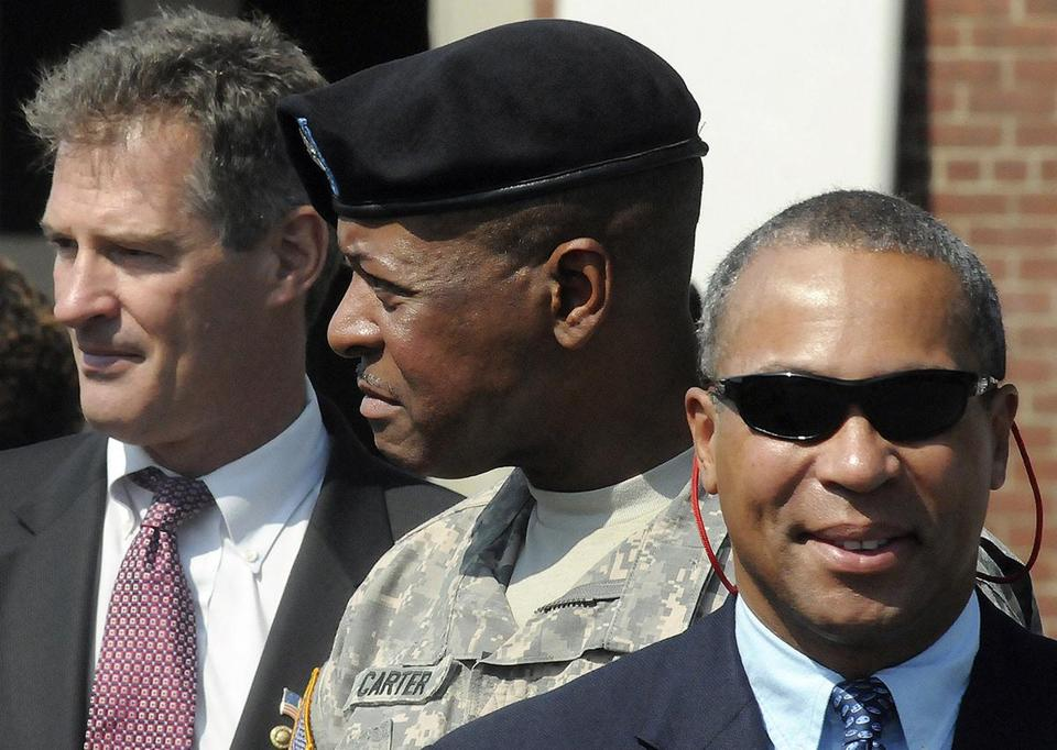 Massachusetts National Guard Commander Joseph Carter  (center) has been on administrative leave since March.