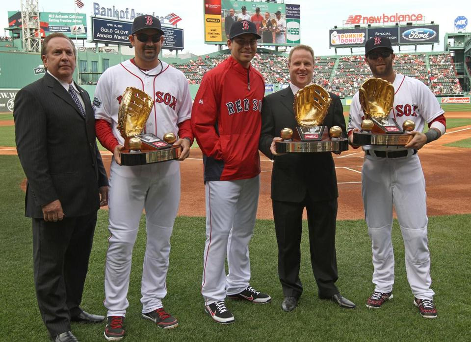 The injured Jacoby Ellsbury (center) was on hand Saturday to pick up awards from last season.