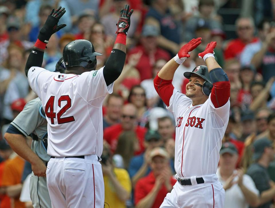Cody Ross (right) gets a warm welcome at home from David Ortiz after belting a three-run HR.