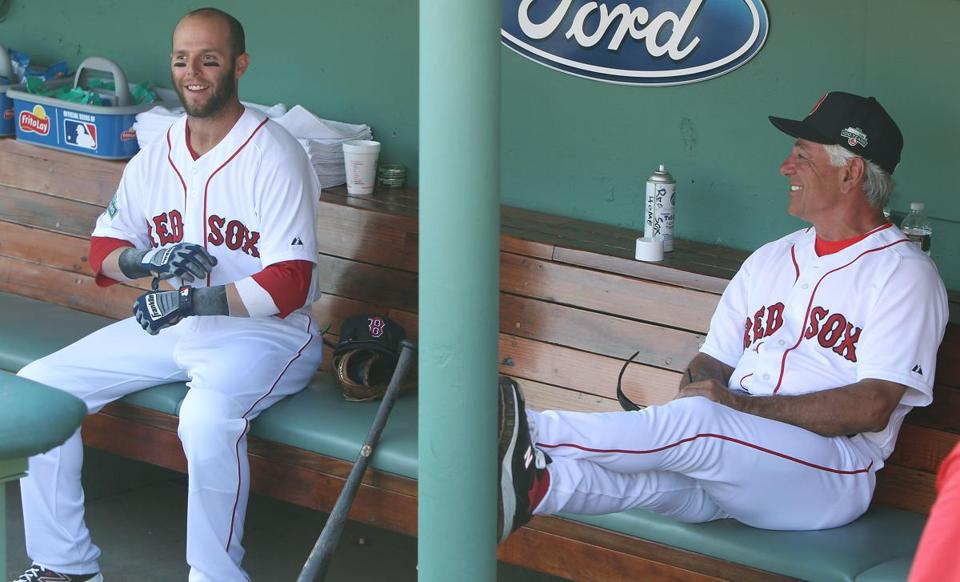 Dustin Pedroia and Bobby Valentine shared a laugh in the dugout before Monday's game.