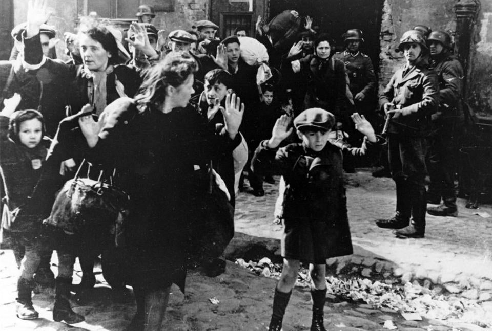 In this April 19, 1943, photo, a group of Jews is escorted from the Warsaw Ghetto by German soldiers.