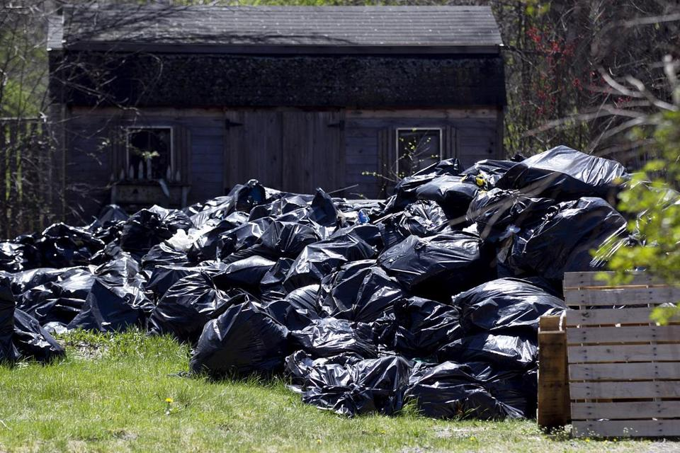 Neighbors have filed complaints over the mounds of garbage bags outside this Osgood Street house in Andover.