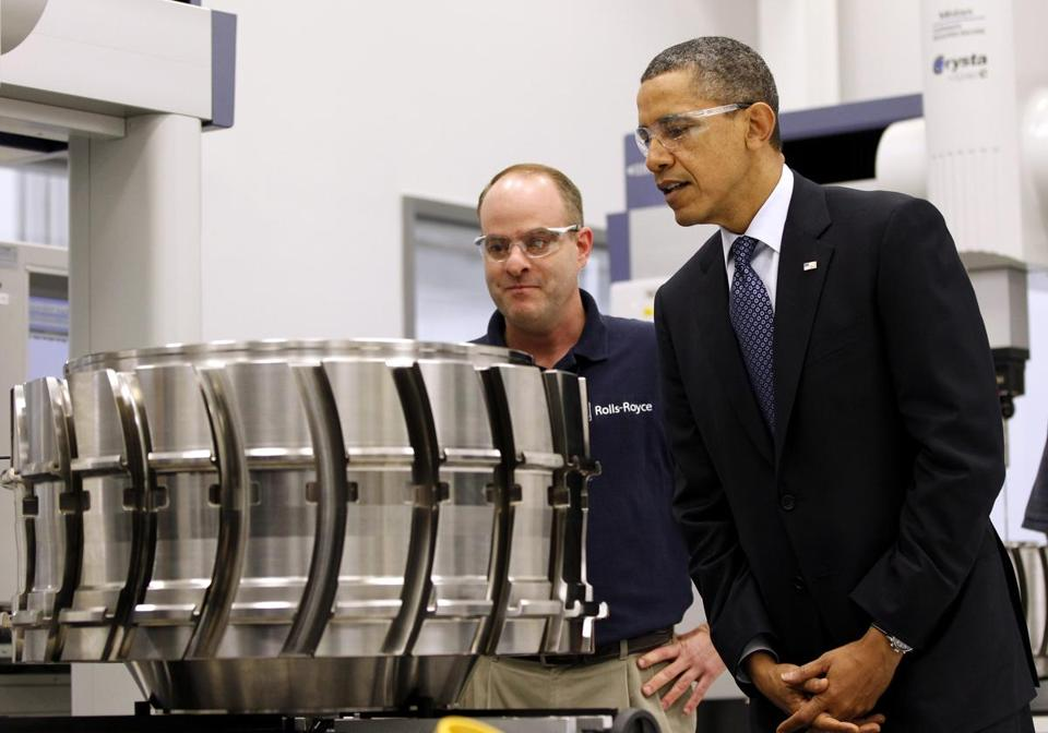 President Obama looks at a aircraft component March 9 with employee Robert Abernathy at the Rolls-Royce Crosspointe jet engine disc manufacturing facility in Prince George, Va. Some view Virginia's community colleges as a model for workforce development.