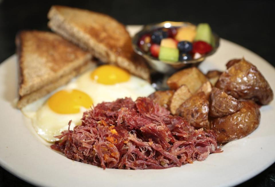A plate of hash, from Deluxe Town Diner in Watertown, is best ordered with a couple of fried eggs, home-fried potatoes, and fruit.