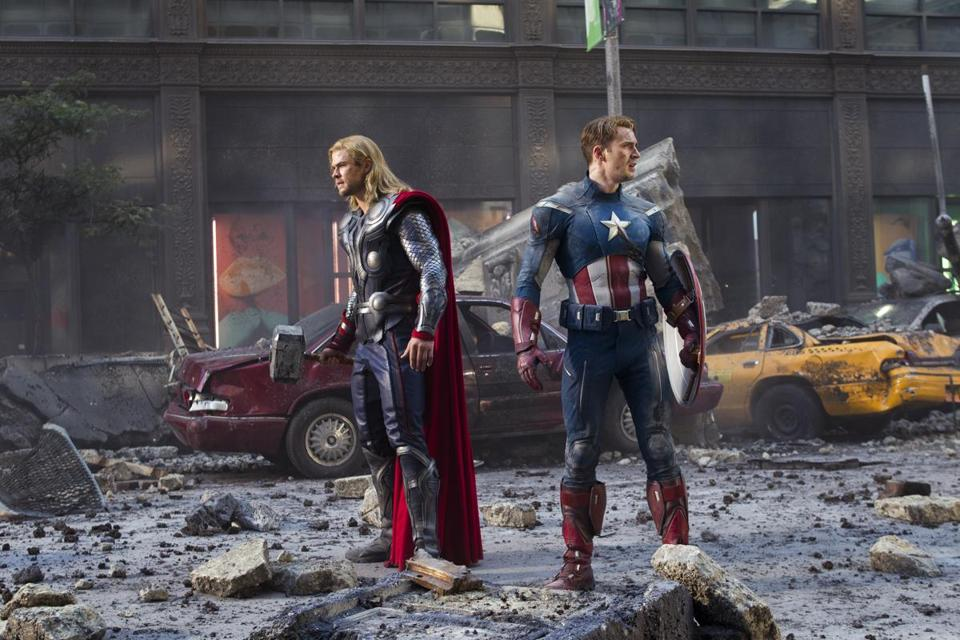 "Chris Hemsworth as Thor and Chris Evans as Captain America in ""Marvel's The Avengers."""