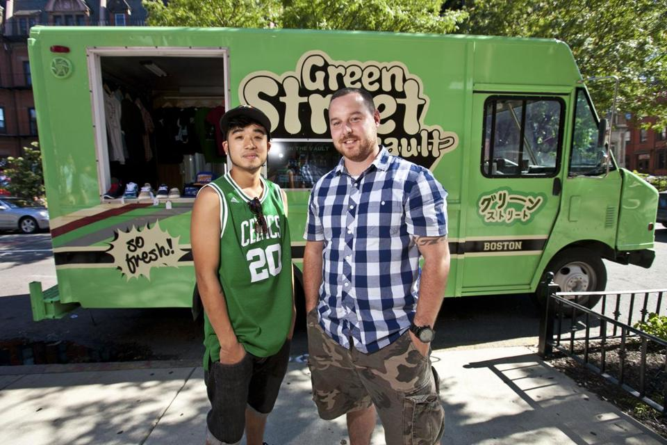 Co-Owners Derrick Cheung, left, and Howard Travis sold clothing on Newbury Street out of their mobile retail truck.