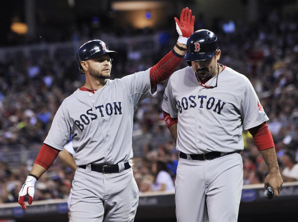 Cody Ross gave a helmet tap to Adrian Gonzalez after they scored on a single by Jarrod Saltalamacchia in the third inning.