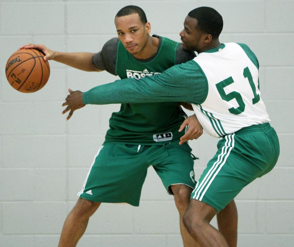 Guard Avery Bradley (left) played keepaway from teammate Keyon Dooling before the official start of yesterday's workout.
