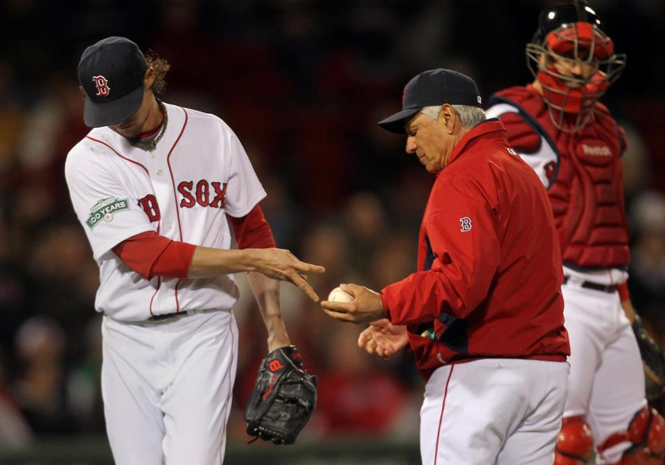 Red Sox pitcher Clay Buchholz handed the ball over to manager Bobby Valentine after allowing 5 runs in the seventh inning against the Athletics.
