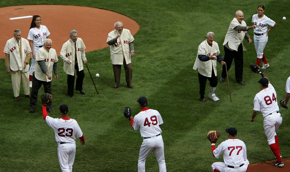 Members of the 1946 Red Sox threw out the first pitches at the home opener.