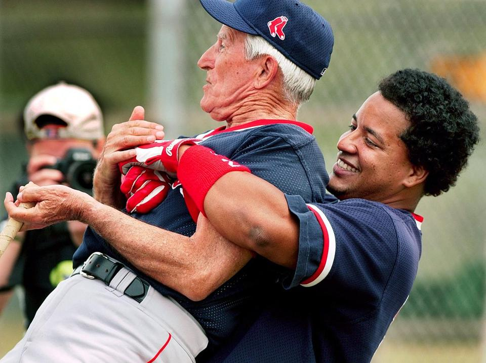Johnny Pesky, with whom Manny Ramirez had some fun in Fort Myers, was happy to be at spring training in early 2002 after new team owner John Henry hired him as an advisor.