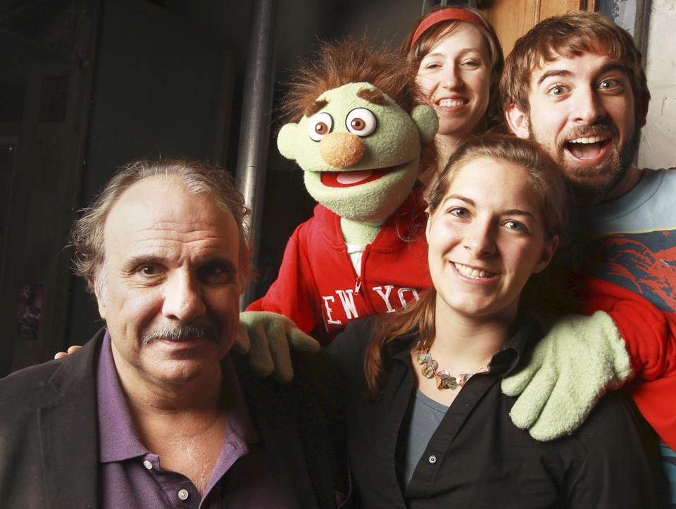 "Director Spiro Veloudos (left) with Elise Arsenault and Phil Tayler, the handlers for Nicky the puppet, and Roxanna Myhrum (foreground), the puppet coach for ""Avenue Q'' at the Lyric Stage Company."