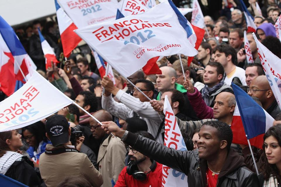 Supporters of the French Socialist Party gathered outside party headquarters ahead of initial results in the French presidential election Sunday.
