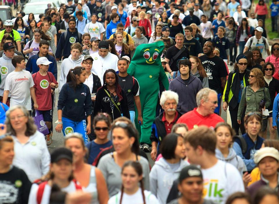 A walker dressed as the 1950s TV character Gumby was among the thousands who  trekked 20 miles to raise funds in the 44th annual Walk for Hunger in Boston Sunday.