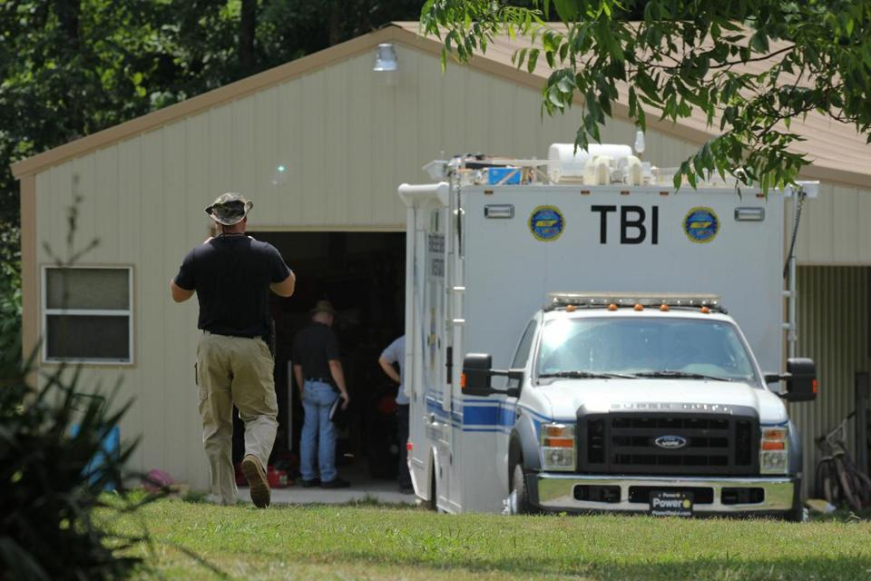 Tennessee Bureau of Investigation agents inspected the home and garage of a woman and her three young daughters who authorities say were abducted near Whiteville, Tenn.