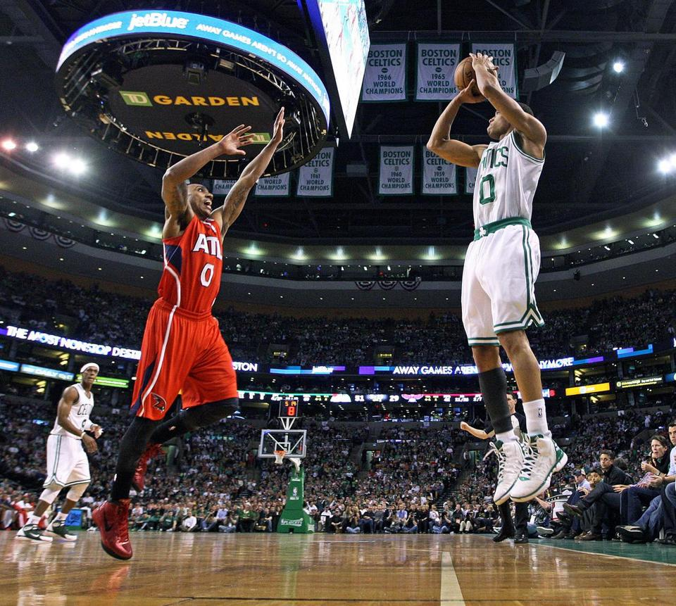 The Celtics' Avery Bradley fires a 3-pointer as the Hawks' Jeff Teague tries some prevent defense. Bradley returned from a shoulder injury to score 6 points.