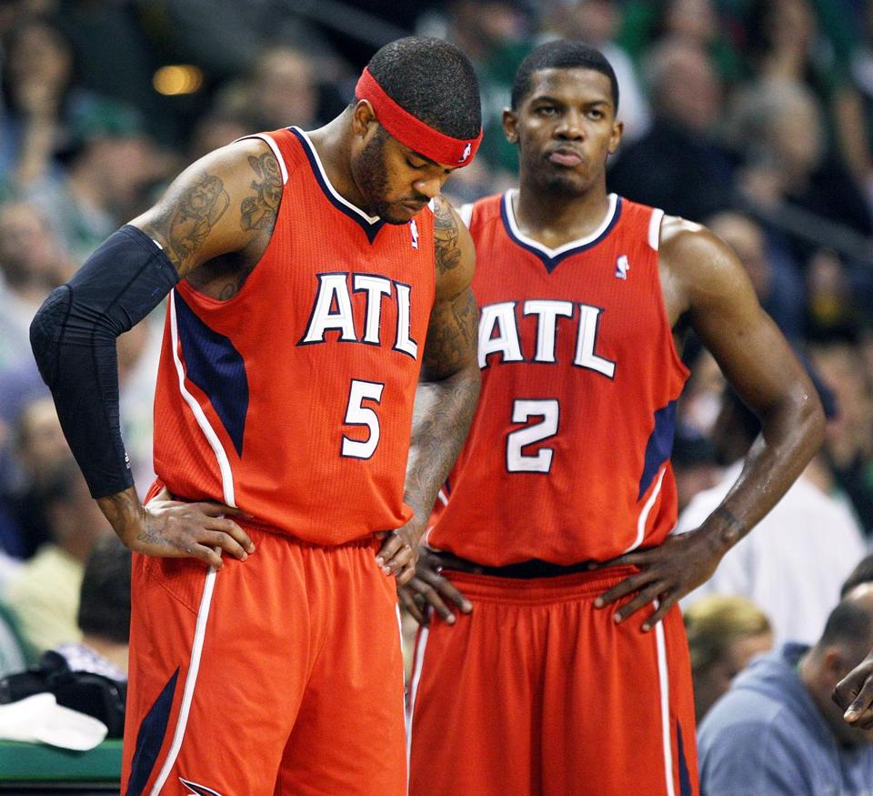 Josh Smith and Joe Johnson are a beat looking pair as they wait for play to resume after a fourth quarter timeout.