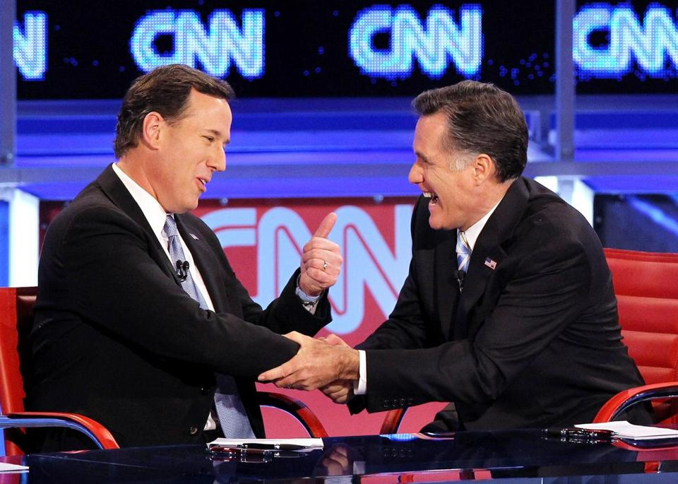 MESA, AZ - FILE: Republican presidential candidates former U.S. Sen. Rick Santorum (L) and former Massachusetts Gov. Mitt Romney talk after participating in a debate sponsored by CNN and the Republican Party of Arizona at the Mesa Arts Center February 22, 2012 in Mesa, Arizona. According to reports, U.S. Sen. Rick Santorum endorsed Republican presidential candidate and former Massachusetts Gov. Mitt Romney as GOP presidential candidate on May 5, 2012. (Photo by Justin Sullivan/Getty Images)