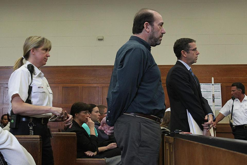Boston, MA., 05/10/12, Film director Dan Adams, center, is sentenced in Suffolk Superior Court after pleading guilty to fraudulent use of the state's film tax credits. Section: Business. Suzanne Kreiter/Globe staff