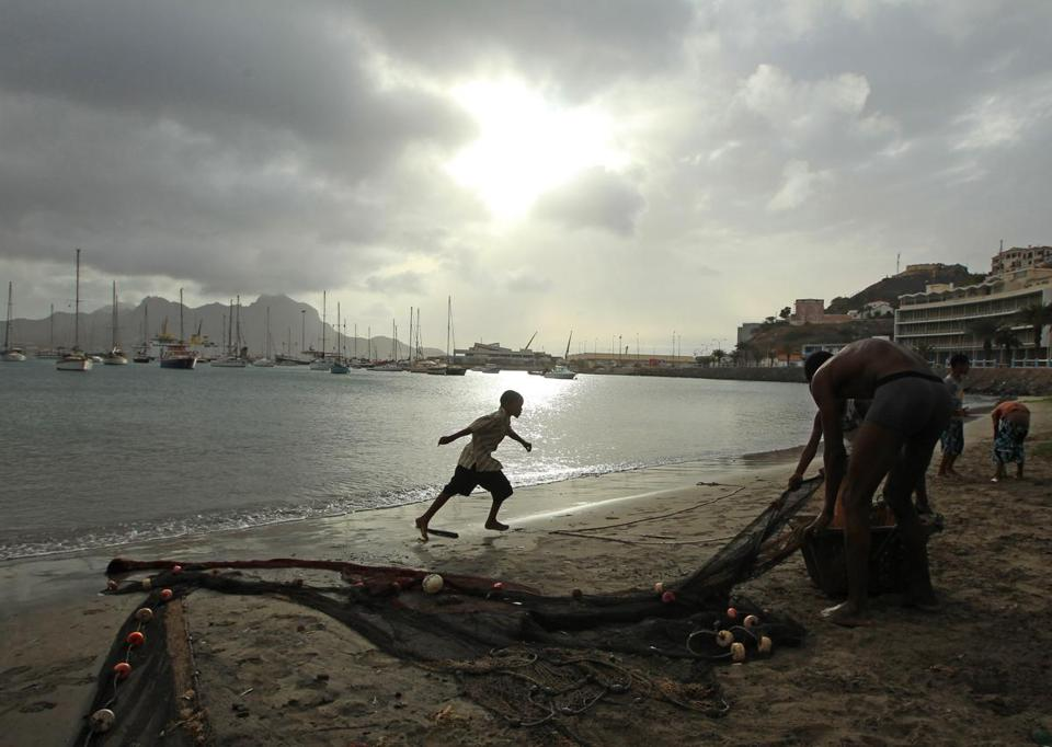 Fishermen in Sao Vicente in Cape Verde pulled in nets. Leaders see schools as the base of their economy.