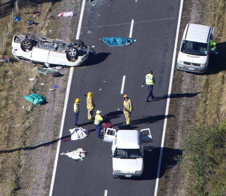 Police and fire crews examined the scene of a minivan crash near Taupo, New Zealand, in which three Boston University students died.