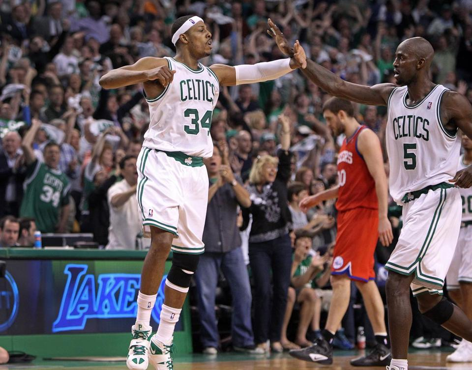 Paul Pierce and Kevin Garnett of the Celtics celebrated during their Game 1 victory over the 76ers on May 12.