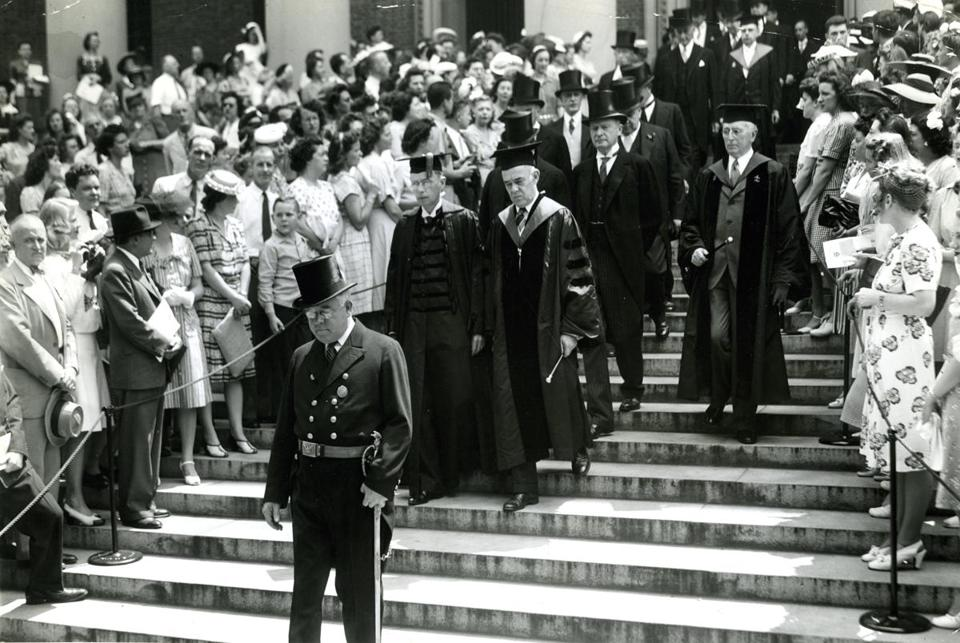 "June 29, 1944: Harvard President James B. Conant and Reginald Fitz, president of the Alumni Association, led graduates down the steps of Widener Library. With combined military and academic ceremonies illustrating – as Conant remarked in his report to the alumni – ""the effect of total war on a university dedicated to the arts of peace,"" Harvard observed its 293d commencement. In all schools of the university, Conant conferred only 251 degrees, the smallest number since 1875."