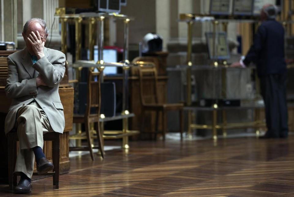A trader reacts on the floor of the Madrid Bourse Wednesday, as European shares sank to new 2012 lows.