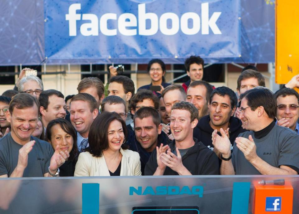 Facebook's Mark Zuckerberg (center) applauds at the opening bell of the Nasdaq stock market on  May 18, 2012, from Facebook headquarters in Menlo Park, Calif.