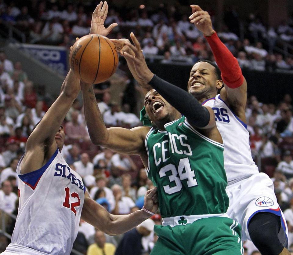 Paul Pierce lost the ball on a second quarter drive as he was double-teamed by Evan Turner (left) and Andre Iguodala (right).