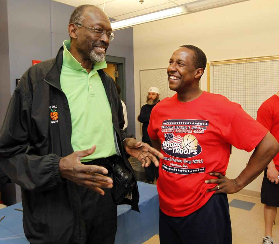 Tom ''Satch'' Sanders (in green) talks with Mayor Setti Warren at Newton South.