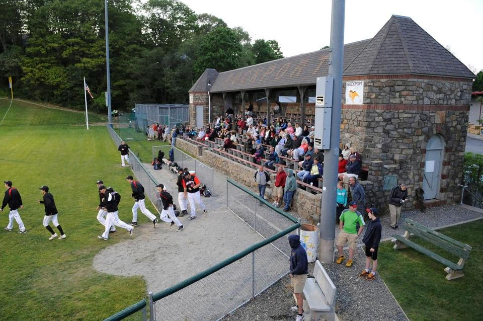 At Rockport's Evans Field, fans gather in the fieldstone grandstand that was built during the Depression as a public works project.