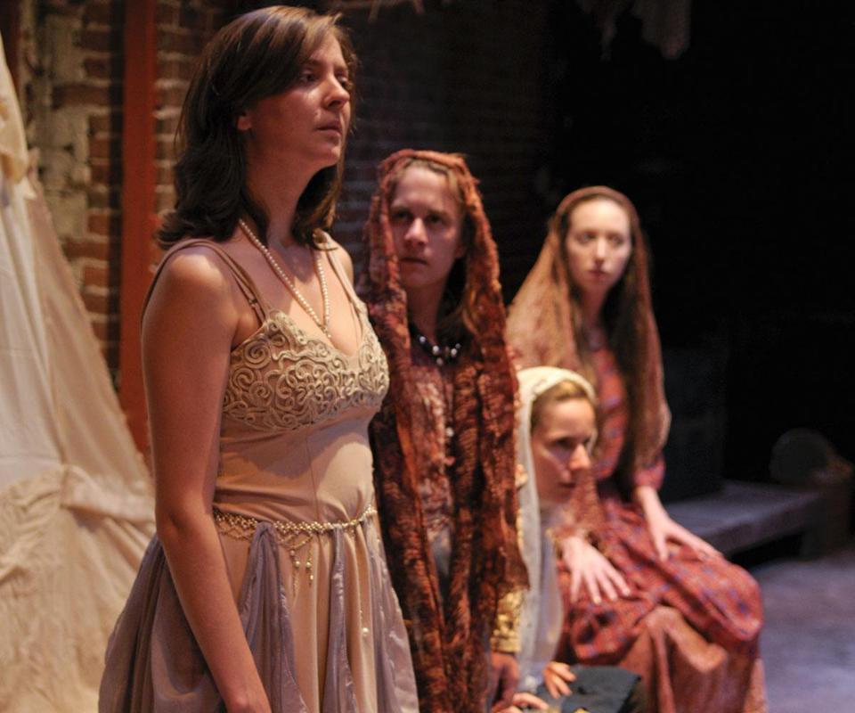 "Aimee Rose Ranger, Jen O'Connor, Mara Radulovic, and Adrienne Paquin in Whistler in the Dark Theatre's production of Euripides's ""Trojan Women."""