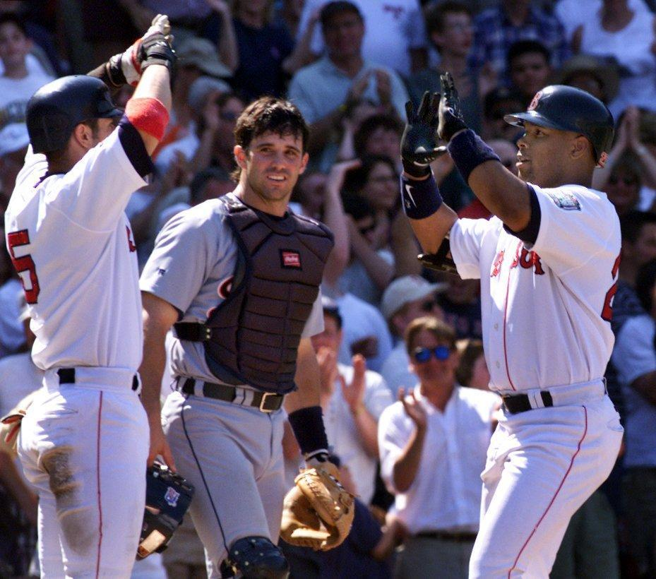 Nomar Garciaparra, left, celebrated with Troy O'Leary after the outfielder's home run in the seventh inning.