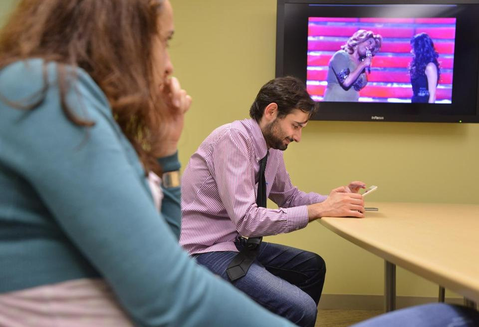 "At Northeastern, Delia Mocann and Micola Perra watch the ""American Idol'' finale in which Jessica Sanchez lost to Phillip Phillips."