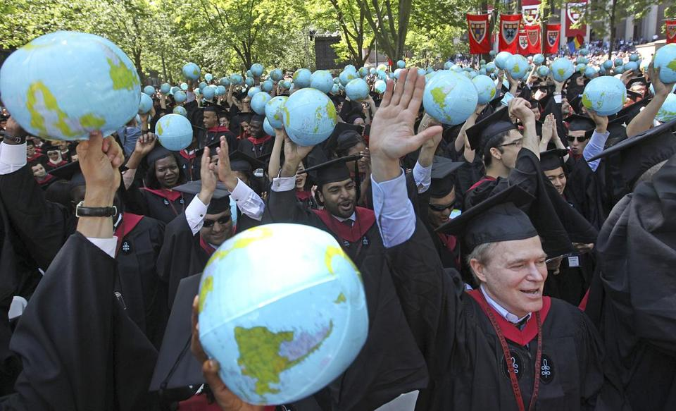 Harvard graduates jubilantly embraced at Thursday's commencement exercises, which featured Fareed Zakaria as speaker.
