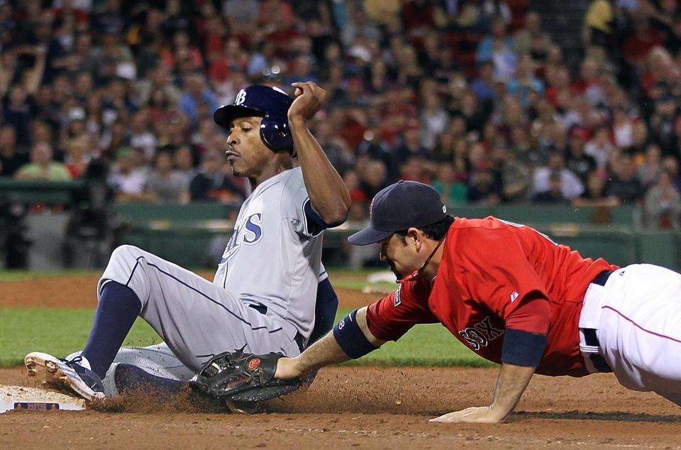 B.J. Upton of the Rays eluded the tag of Adrian Gonzalez to return safely to first in the seventh inning.