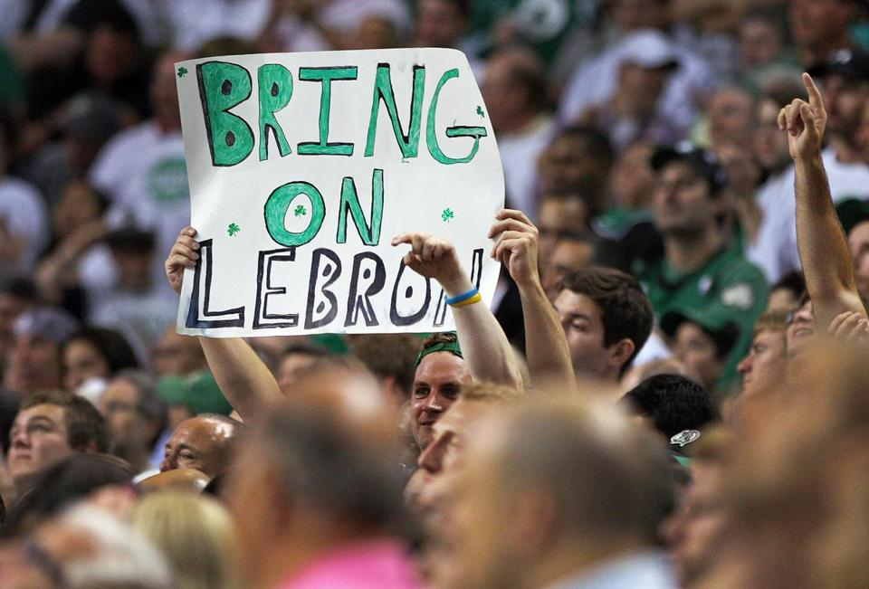 "5-26-12: Boston, MA: This fan came prepared, as he flashes a sign reading ""Bring on LeBron"" late in the game, and his wish will come true as the Celtics will face the Heat in the Eastern Conference Finals. The Boston Celtics hosted the Philadelphia 76ers for Game Seven of the NBA Eastern Conference Semi-Finals playoffs at the TD Garden. (Globe Staff Photo/Jim Davis) section: sports topic: Sixers-Celtics"