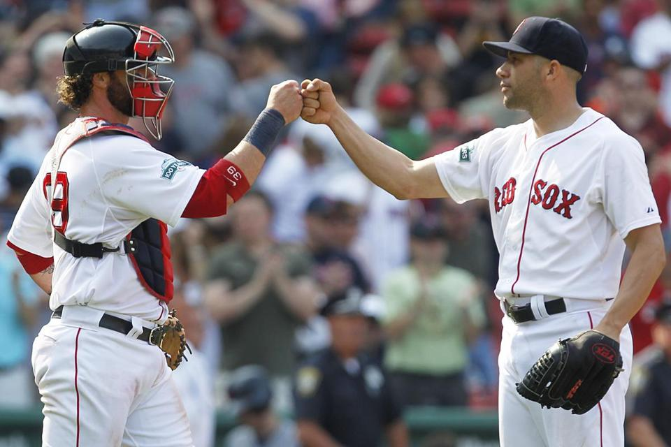 Red Sox closer Alfredo Aceves fist bumped catcher Jarrod Saltalamacchia after closing out the Tigers.