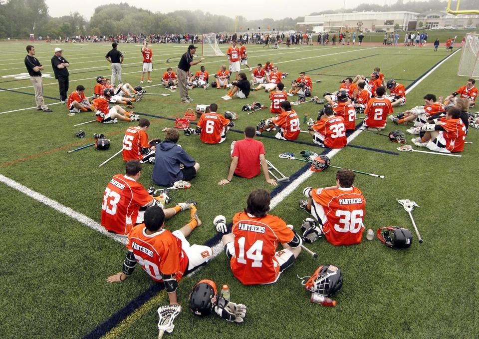 Lacrosse players on Beverly High's new artificial turf field.