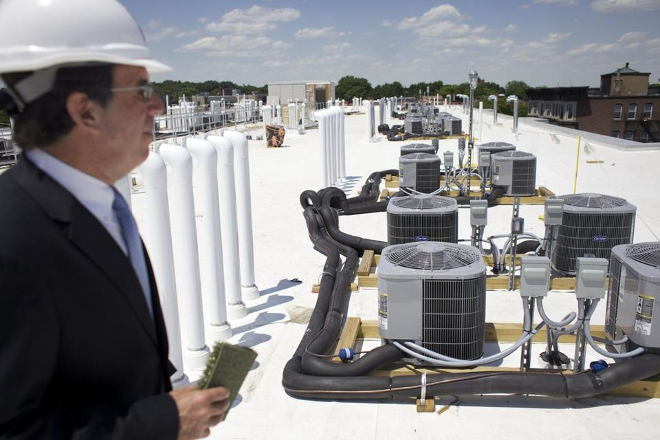 Bruce A. Percelay, chief executive of The Mount Vernon Co., on the roof of one his company's buildings in the green district.