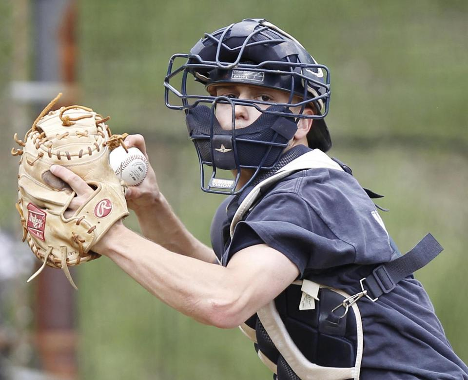 Peabody High School catcher Genaro Ciulla takes part in a practice in Peabody this past Wednesday.