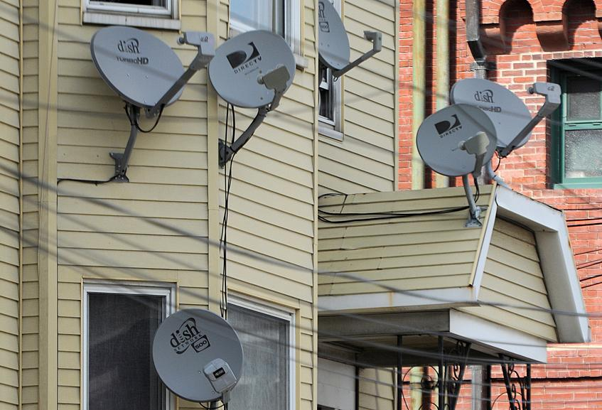 Satellite dishes dotted a house on Saratoga Street.