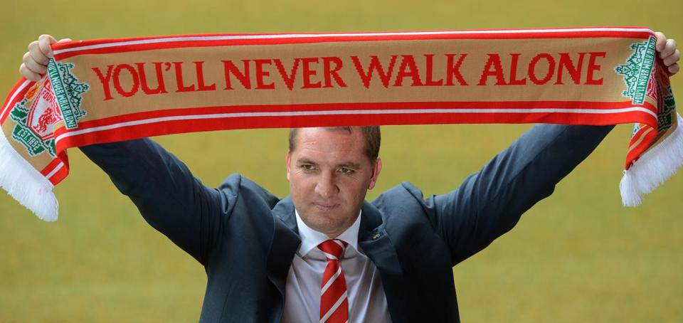 Newly appointed Liverpool football club manager Brendan Rodgers posed for photographers with a team scarf to announce his arrival at Anfield in Liverpool Friday.