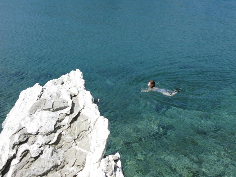 Nina Schoff swims off the island of Poros.